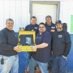 Richmond County Rescue Squad gets underwater camera from auto businesses, riding club